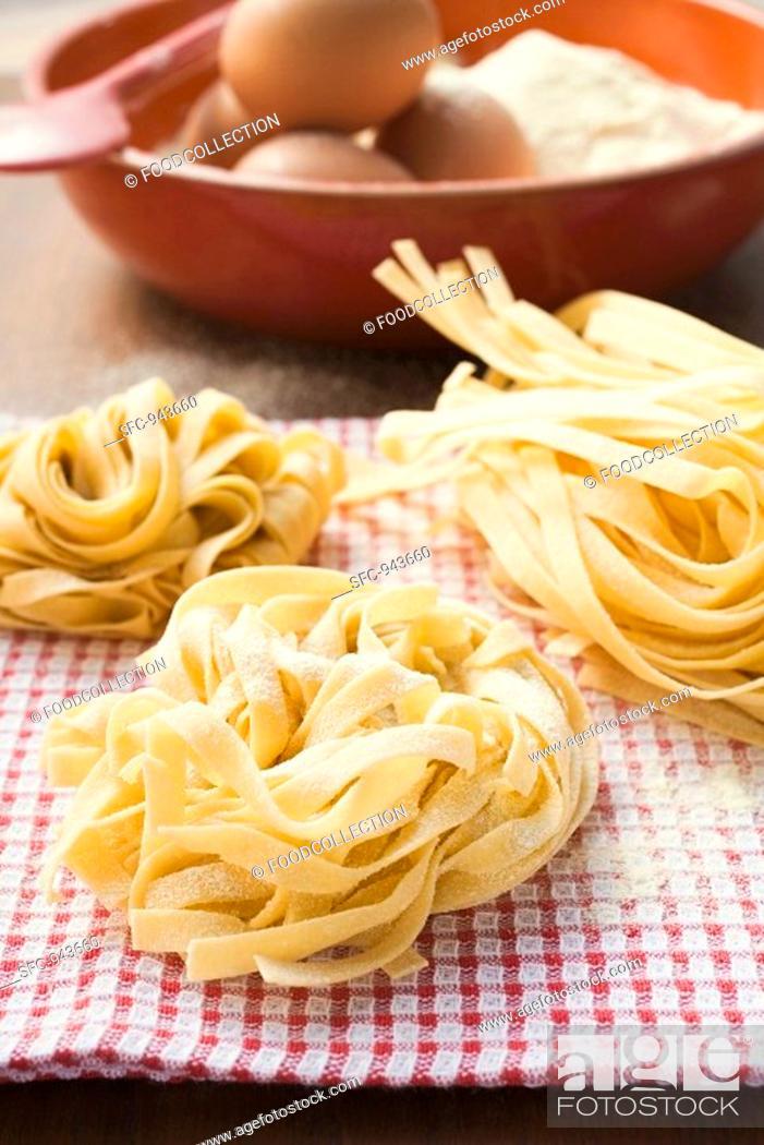 Stock Photo: Three ribbon pasta nests.