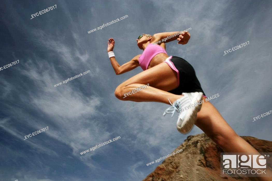Stock Photo: Caucasian woman sprinting.