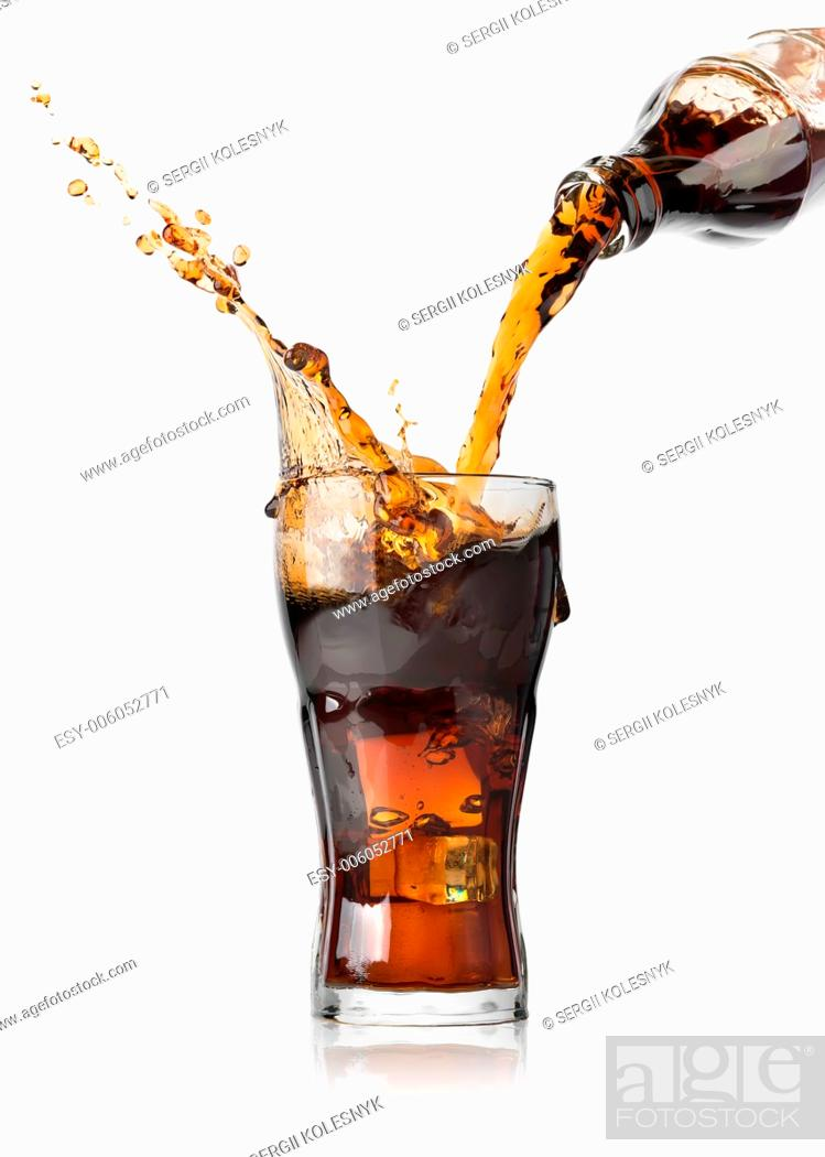 Stock Photo: Cola pouring from a bottle into a glass.
