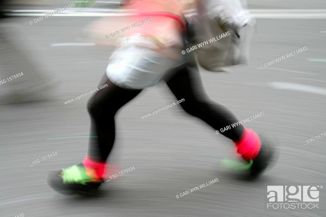 Stock Photo: trendy young woman walking in street in city town.