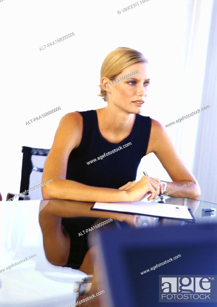 Stock Photo: Businesswoman sitting at desk.