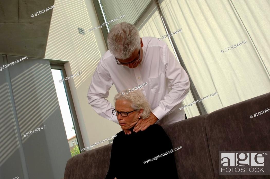 Stock Photo: Senior man strangling his wife.