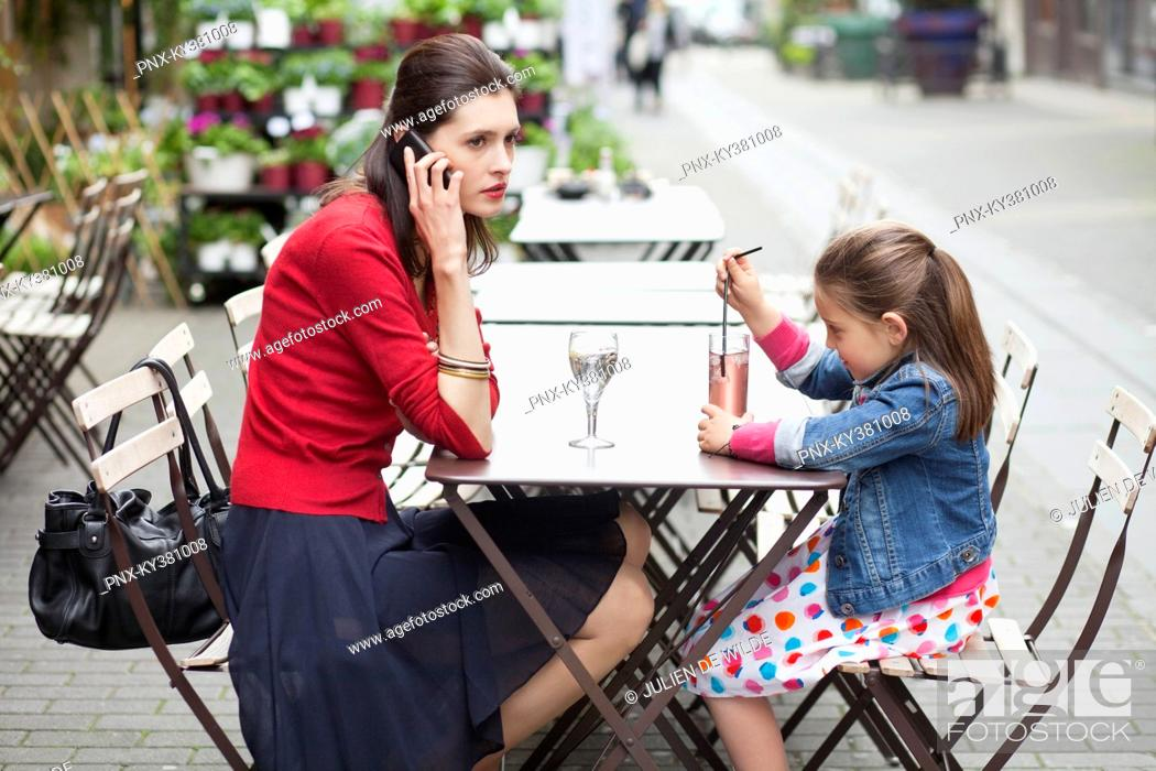 Stock Photo: Woman with her daughter sitting in a cafe.