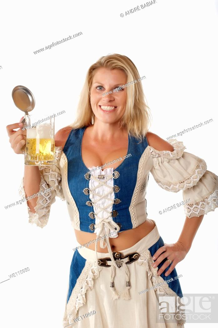 Stock Photo: Attractive woman in traditional german dirndl outfit with beer mug.