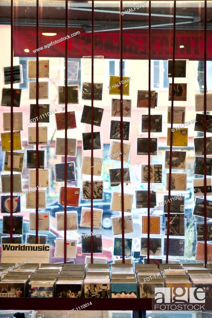 Stock Photo: A window display of hanging compact discs in a record shop.