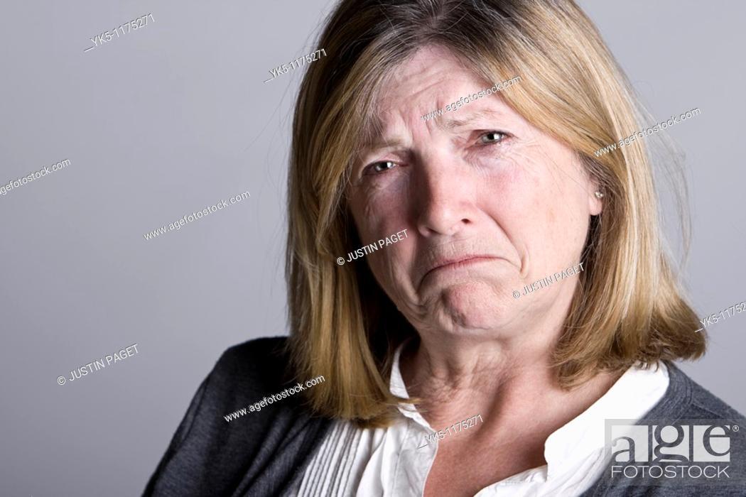 Stock Photo: Powerful Shot of a Sad Looking Senior Lady.