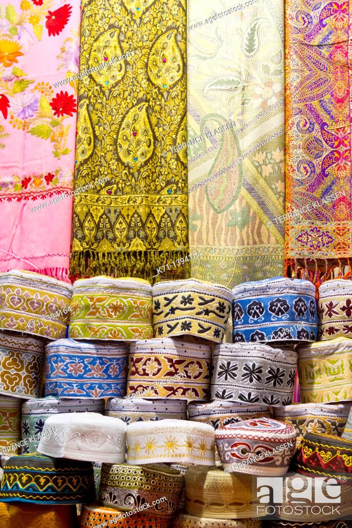 Closeup of textiles, scarves and hats for sale at the Muttrah souq