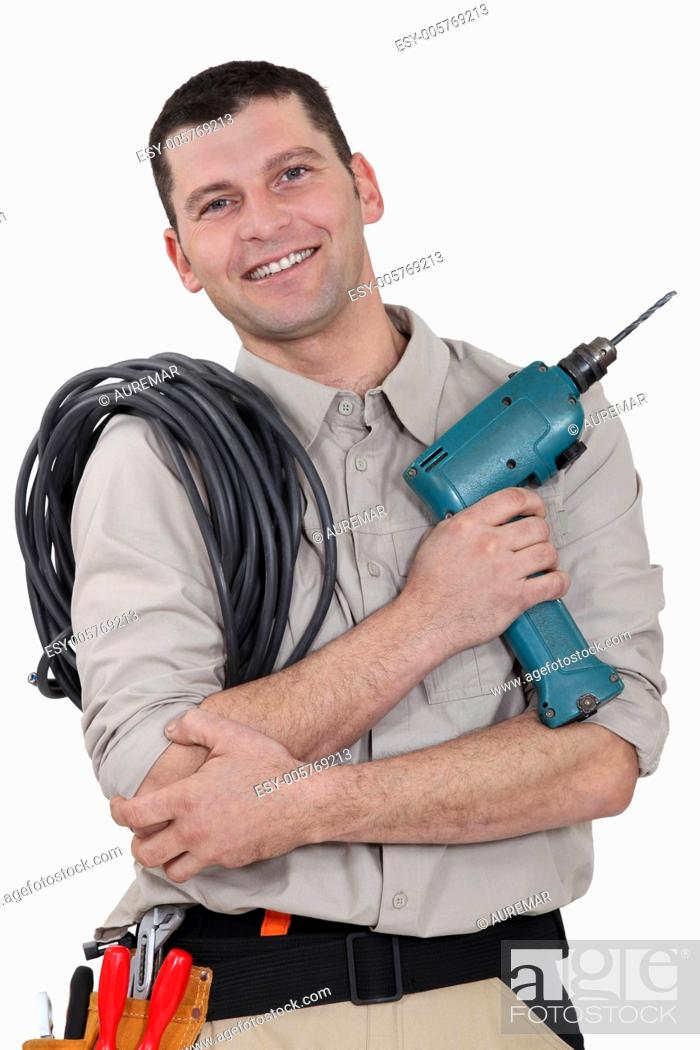 Stock Photo: Electrician with drill and cable.