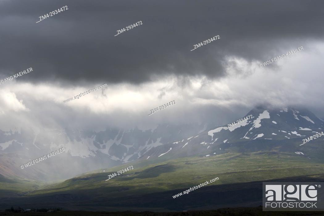 Stock Photo: View of the Borgarfjodur and the Skardsheidi mountain range in the rain near Hvanneyri in western Iceland.