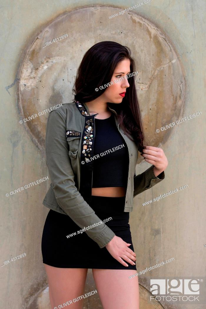 Stock Photo: Portrait of a young woman in black top and skirt.