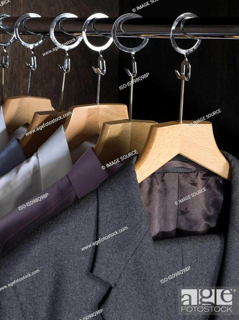 Stock Photo: Shirts and suits in a closet.