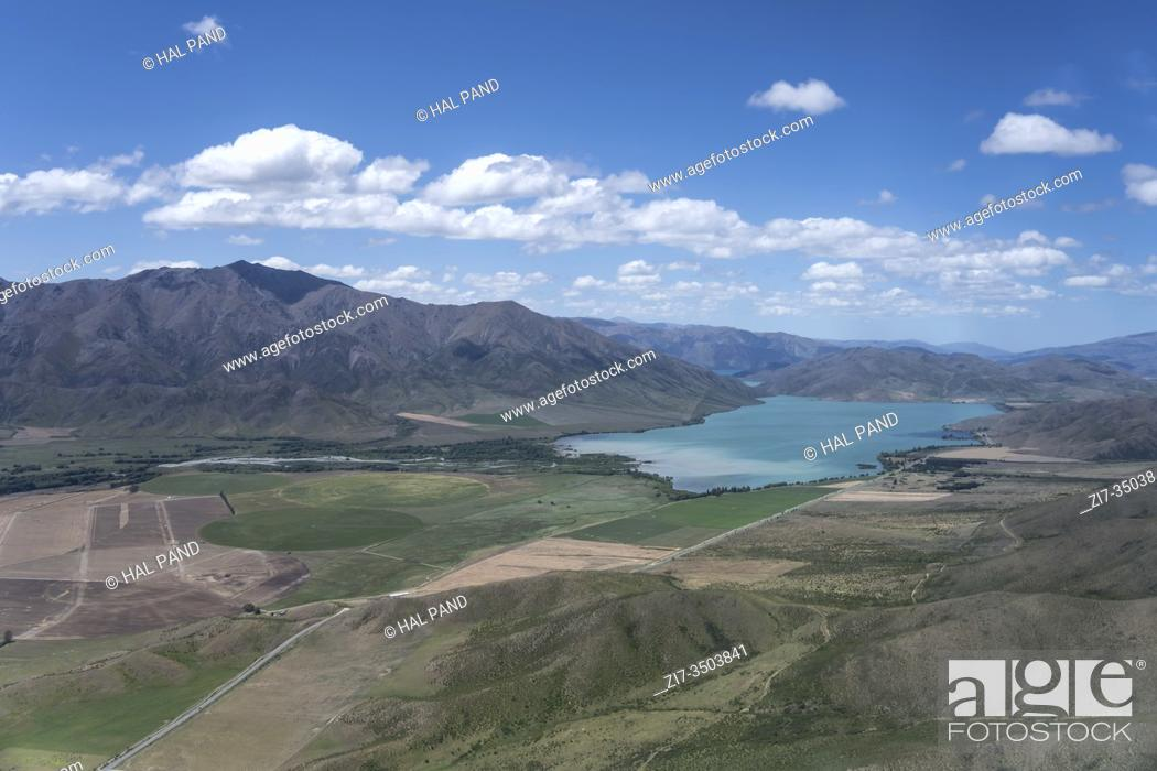 Stock Photo: aerial, from a glider, of Benmore lake in valley with barren slopes, shot in bright spring light from north-west, Canterbury, South Island, New Zealand.