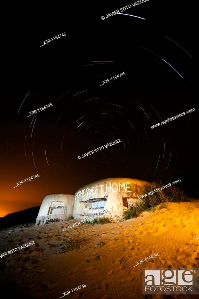 Stock Photo: Old abandoned military bunker, with a starry sky.