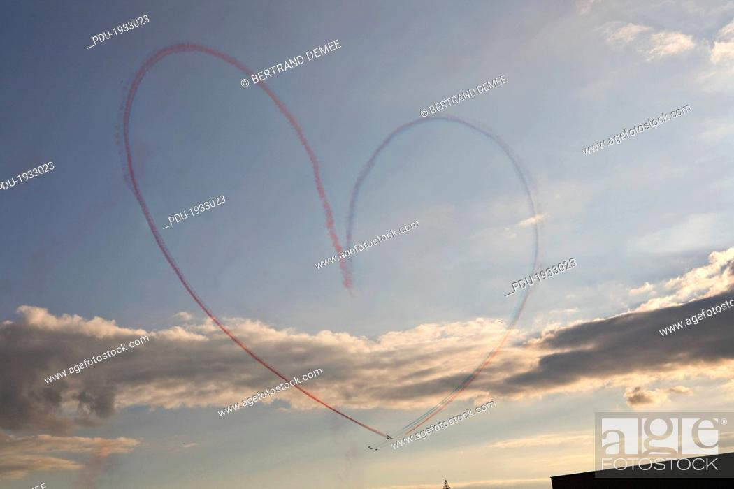 Stock Photo: Heart drawn on sky by airplanes.