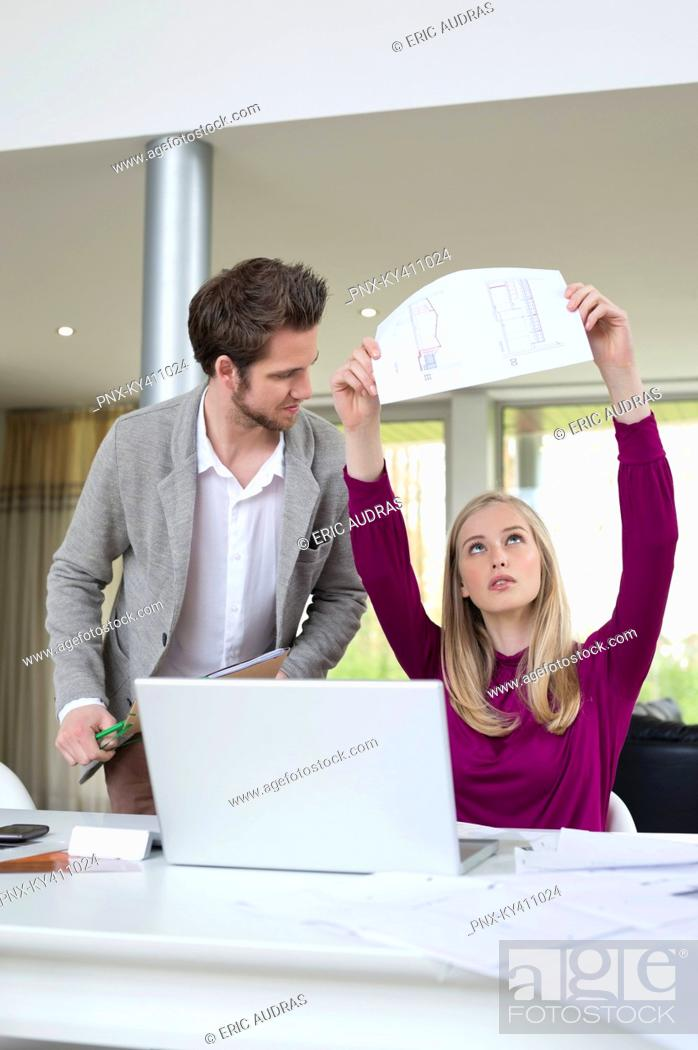 Stock Photo: Woman examining an architectural design in the office.