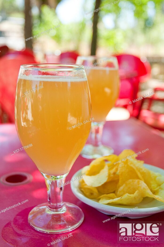 Stock Photo: Spanish aperitif: two glasses of clara beer with lemon and chips in a terrace. Spain.