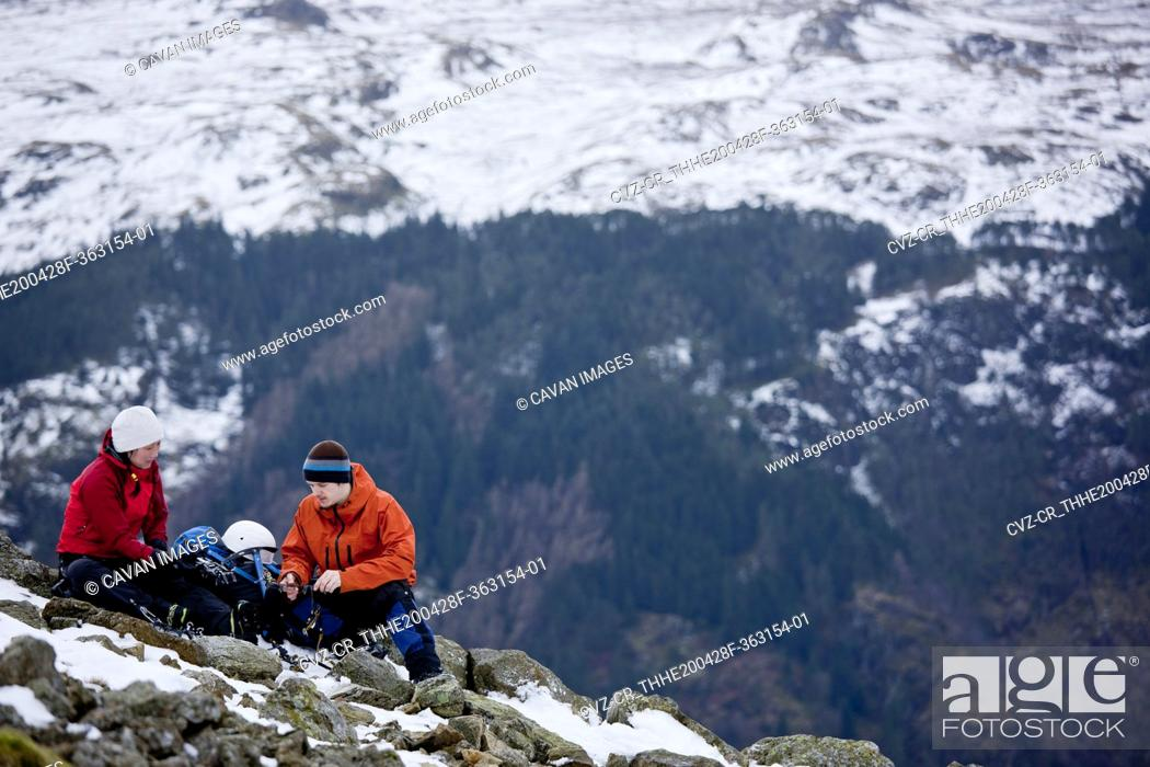 Stock Photo: couple resting on the way up Helvellyn mountain in the Lake District.