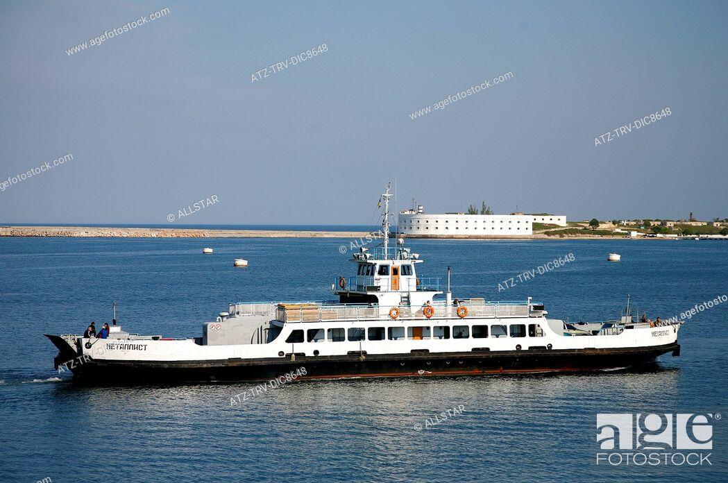 Stock Photo: LOCAL FERRY ON BLACK SEA & SEA FORTRESS; SEVASTOPOL, CRIMEA, UKRAINE; 30/04/2008.