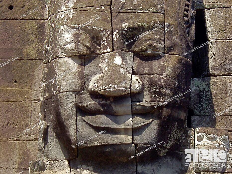 Stock Photo: Stone face tower at Bayon temple, Cambodia.