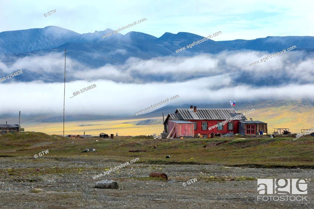 Stock Photo: Red house, Doubtful Village, Doubtful Village, Wrangel Island, Far Eastern Federal District, Russia.