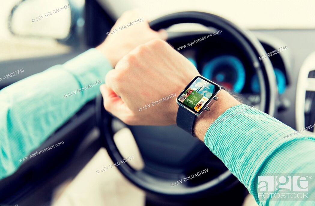 Stock Photo: transport, business trip, technology, media and people concept - close up of man with news application on smartwatch driving car.