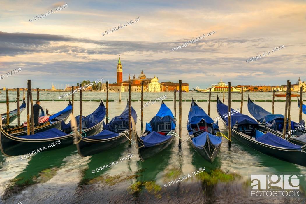 Imagen: Gondolas Tied up on the Grand Canal across from San Giorgio Maggiore Venice Italy World Location.