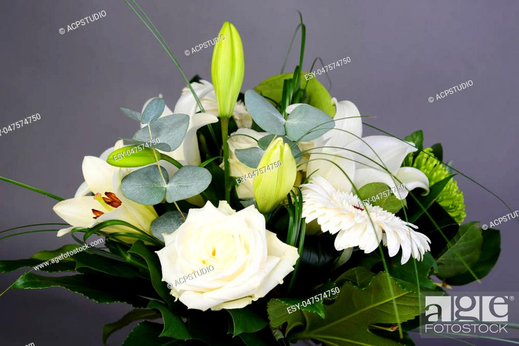 Stock Photo: bouquet bunch of beautiful white flowers with white roses, lily and daisy.