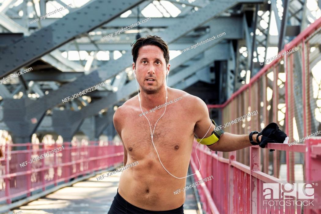 Stock Photo: Portrait of man on bridge.