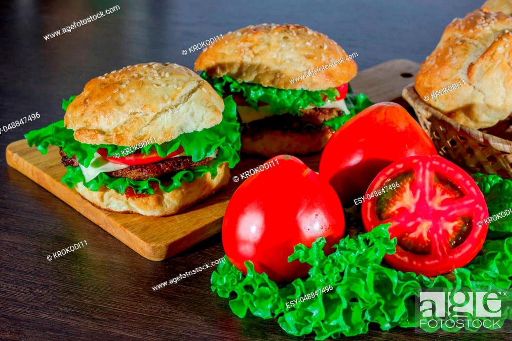 Stock Photo: Close-up of home made tasty burgers on wooden table.