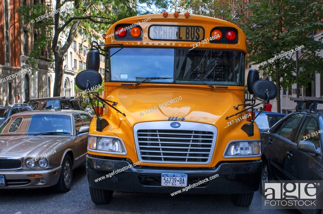 Stock Photo: United States, New York City, Manhattan, school bus and jaguar XJ car. A school bus (also called schoolbus) in North America is a type of bus specifically.