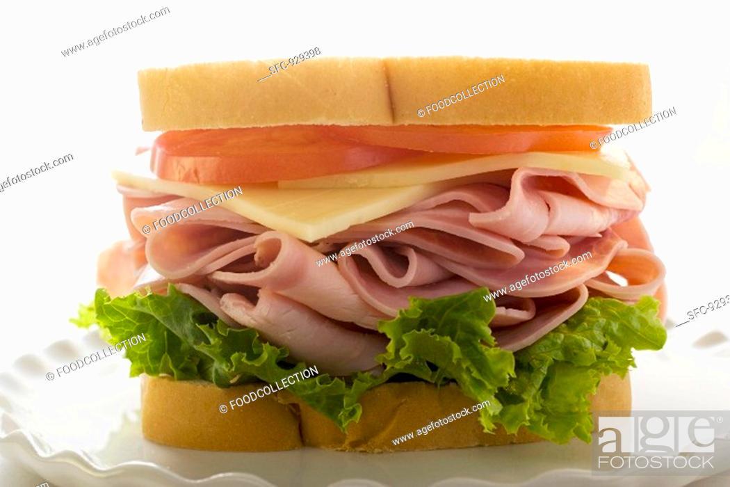 Stock Photo: Ham, cheese and tomato sandwich.