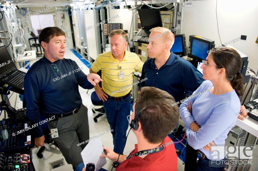 Stock Photo: NASA astronauts Steve Lindsey (second left), STS-133 commander; along with Michael Barratt (left), Tim Kopra and Nicole Stott, all mission specialists.
