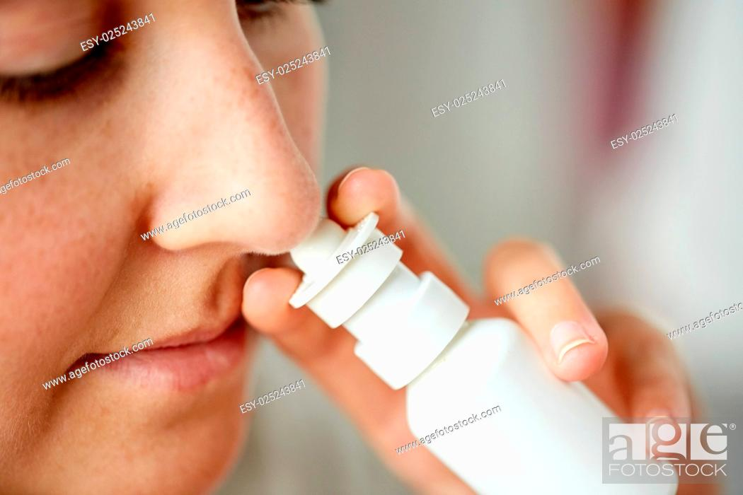 Stock Photo: healthcare, flu, rhinitis, medicine and people concept - close up of sick woman using nasal spray.