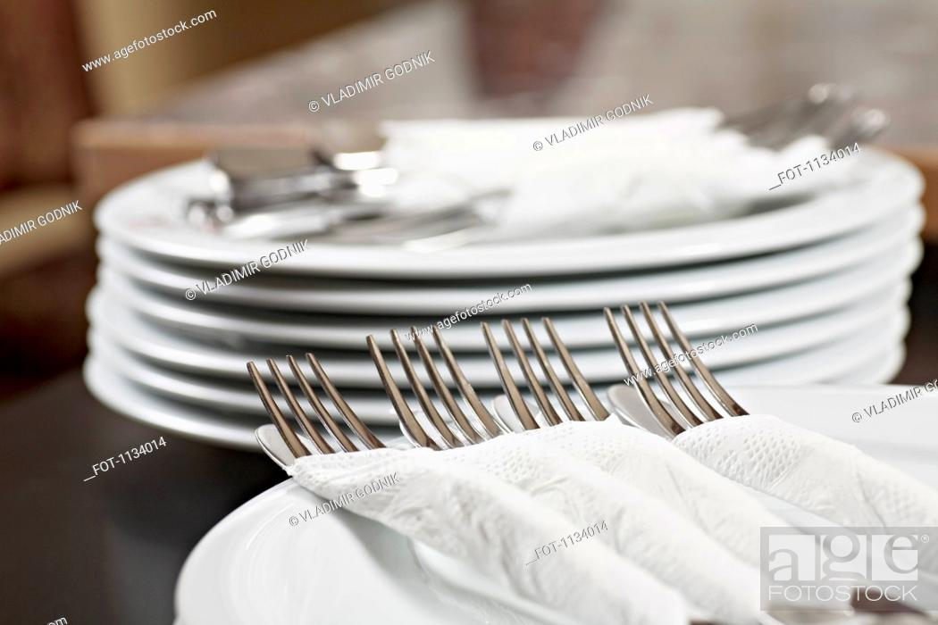 Stock Photo: Forks and knives wrapped in paper napkins.