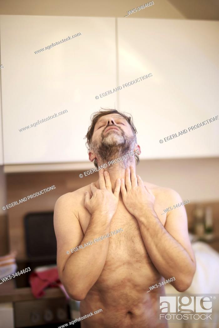 Stock Photo: Nude man at home.