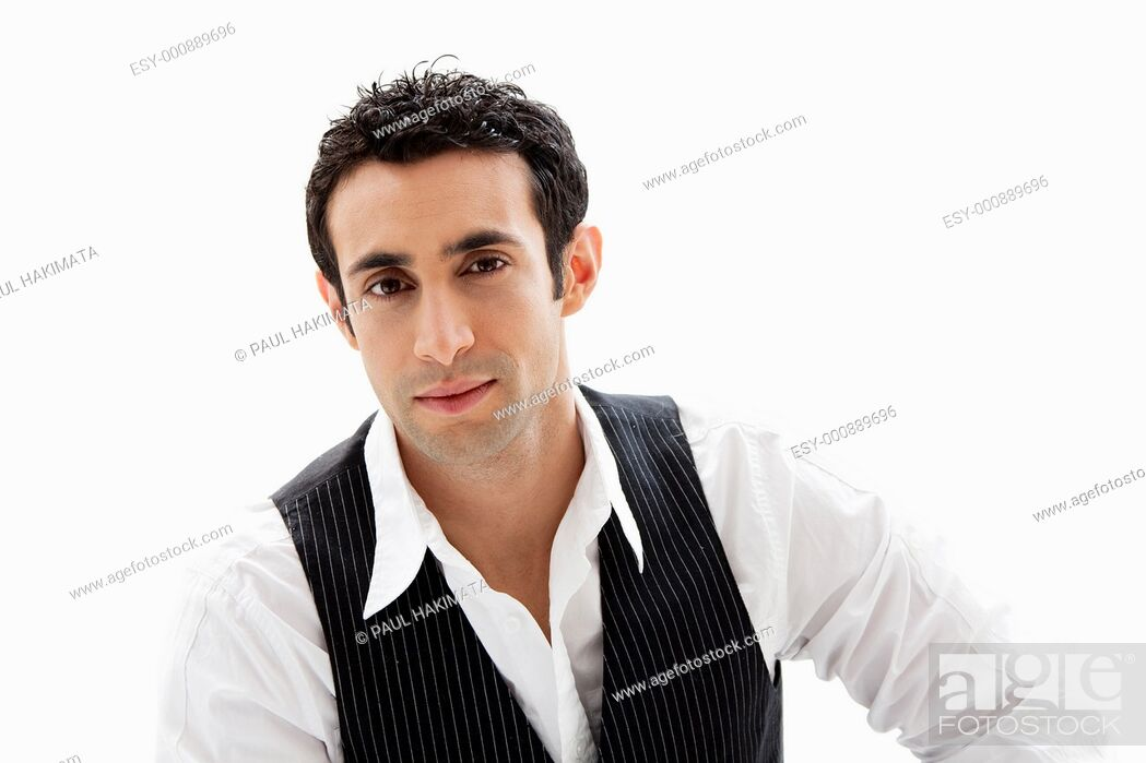 Stock Photo: Handsome male wearing a white shirt and black pinstripe vest, isolated.