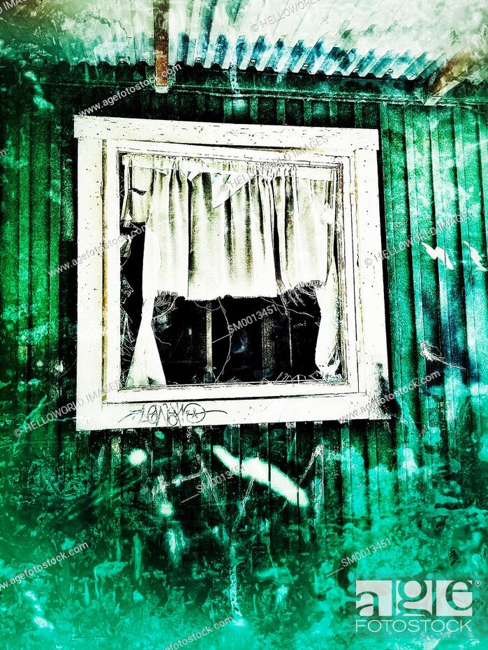 Stock Photo: Broken window and torn curtain of small house, Sweden, Scandinavia.