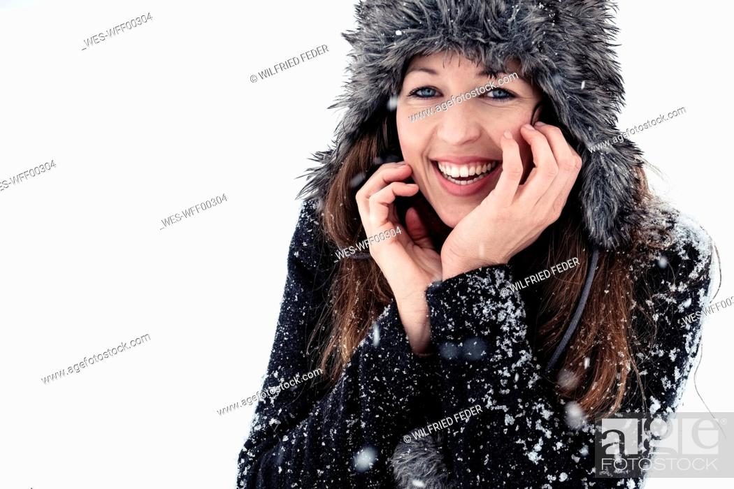 Stock Photo: Portrait of laughing young woman in winter.