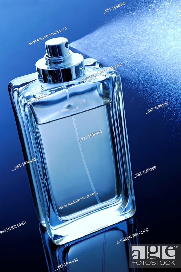 Stock Photo: Perfume Bottle with Spray.