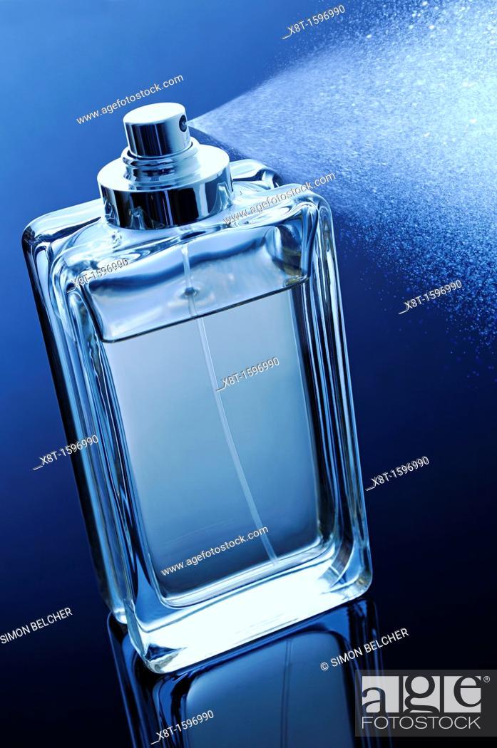 Stock Photo: Perfume Bottle with Spray.