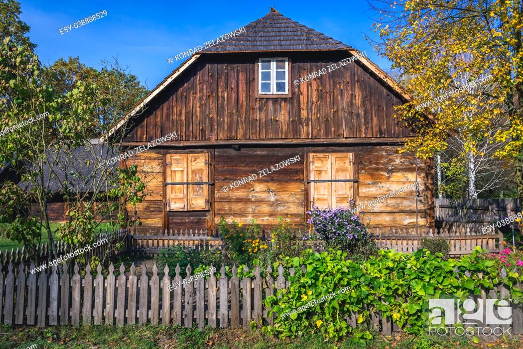 Stock Photo: Wooden cottage in Ethnographic Heritage Park, part of Museum of Kampinos Forest in Granica, small village in Kampinos Forest, Poland.