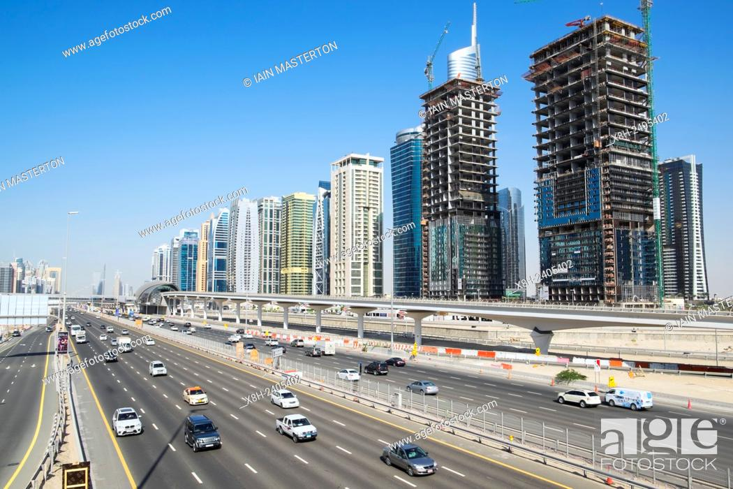 Stock Photo: Skyline of Jumeirah Lakes Towers (JLT) and Sheikh Zayed Road in Dubai United Arab Emirates.