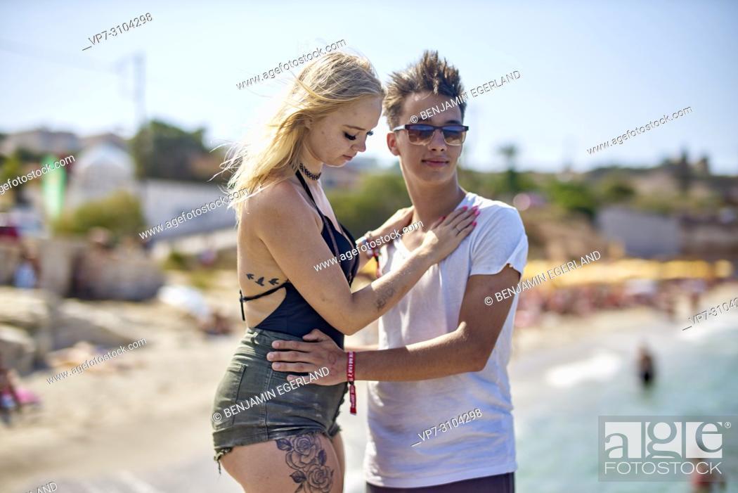 Stock Photo: Greece, Crete, Chersonissos, couple at holiday beach, sunny weather.