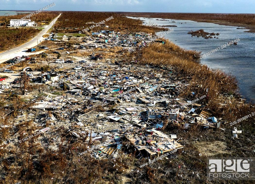 Stock Photo: September 11, 2019, Freeport, BHS: View of the Sand Banks neighborhood where mostly Haitians lives on the the S.C.Bootle Highway on Treasure Cay in Abaco.