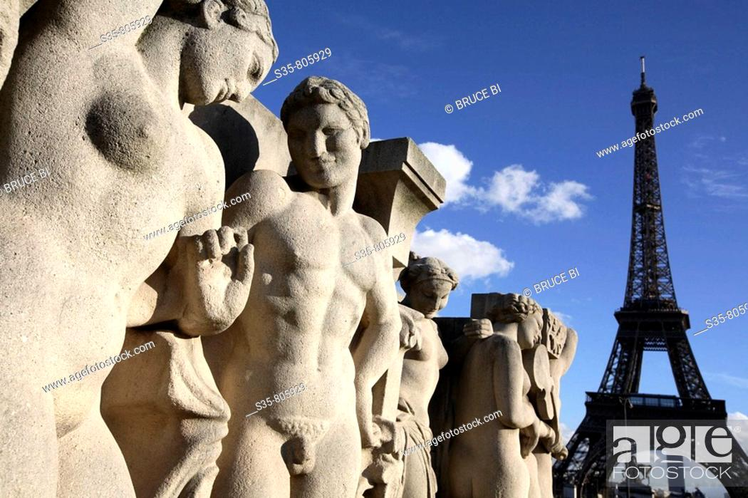 Stock Photo: Closed up view of the stone sculptures at the base of the Chaillot pool with Eiffel Tower in background, Paris. France.