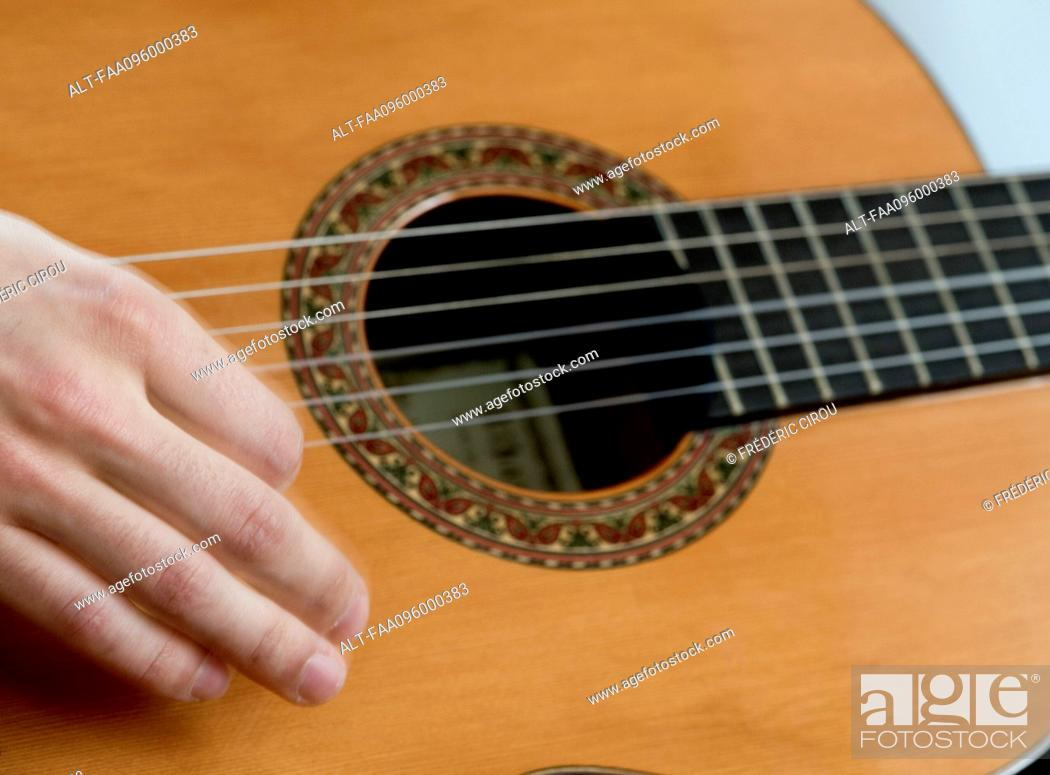 Stock Photo: Musician playing acoustic guitar, close-up.