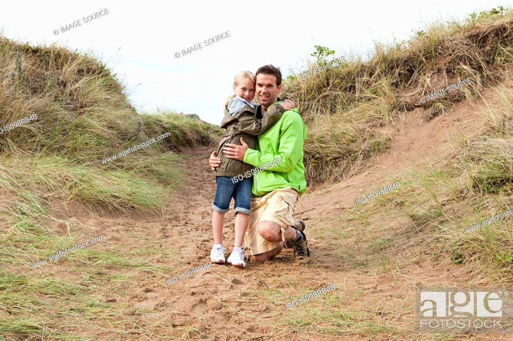 Stock Photo: Father and daughter on a dune.