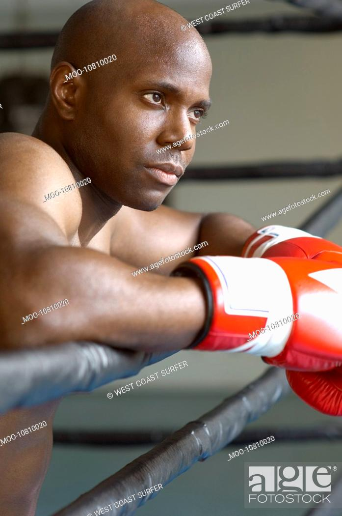 Stock Photo: Boxer resting on boxing ring head and shoulders.
