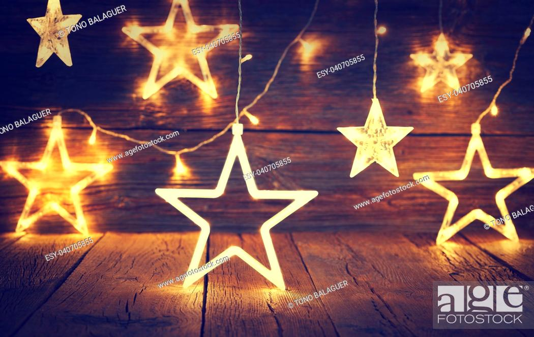 Stock Photo: Christmas light stars vintage rustic wooden background decoration.