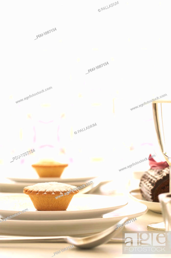 Stock Photo: Mince pies on plates.